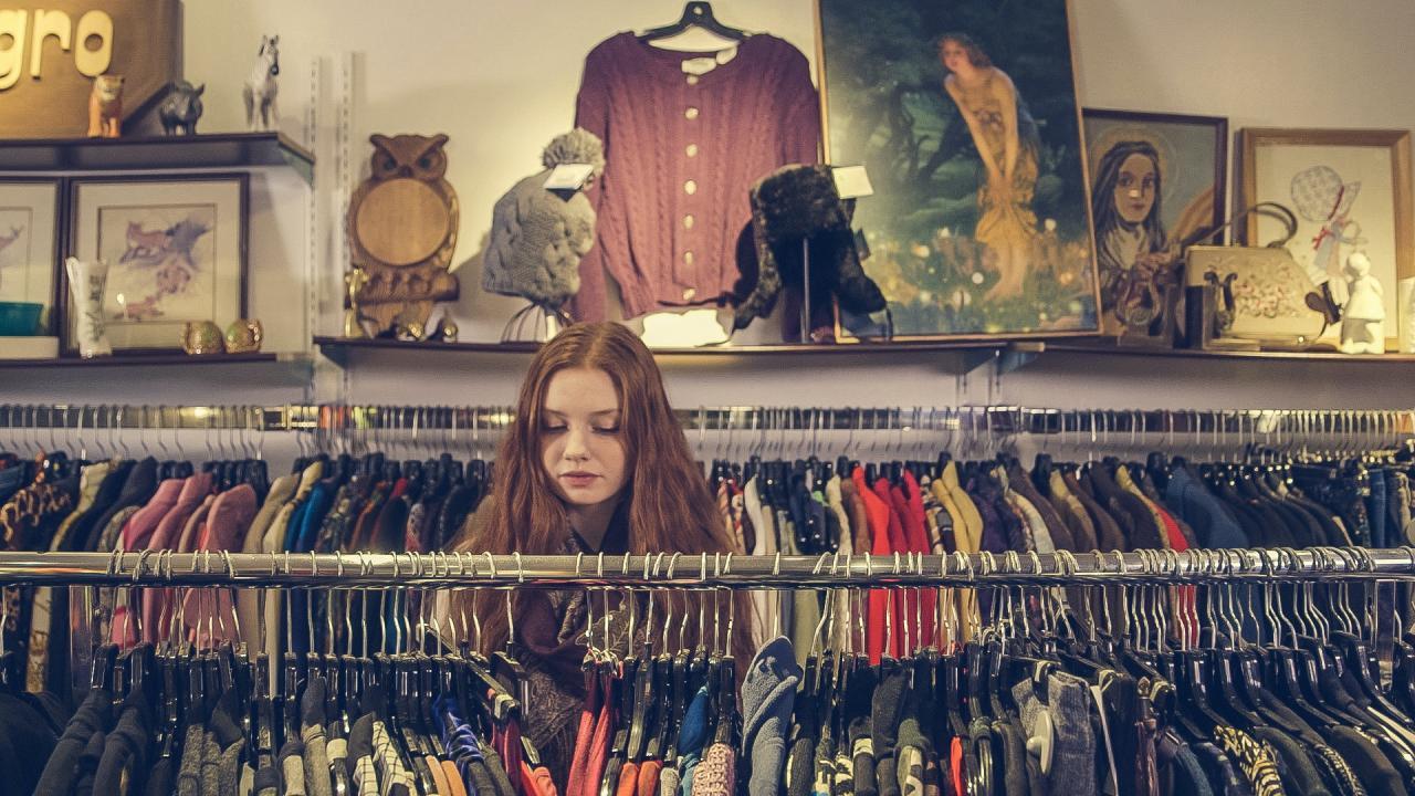 Photo of Woman Near Clothes · Free Stock Photo